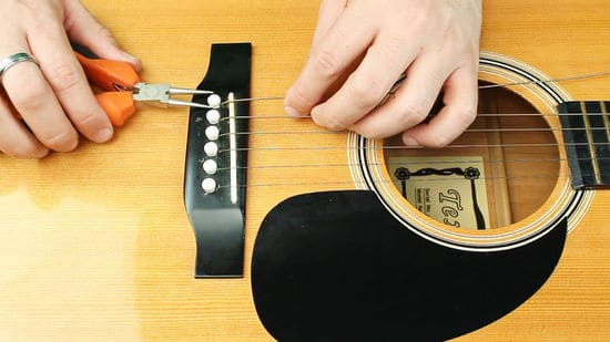 stringing a guitar