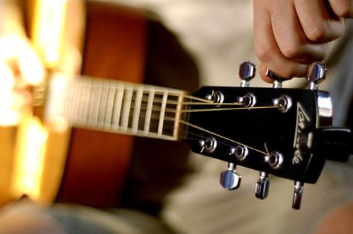 tuning a guitar