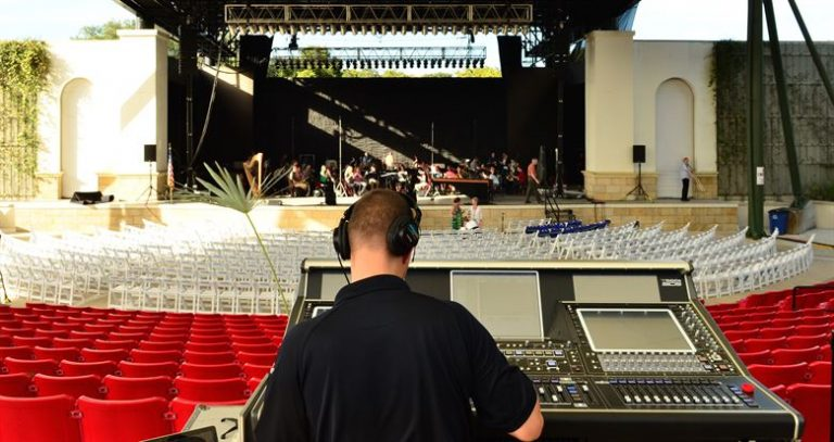 The front of house engineer manages audio equipment and sets it up before the concert.