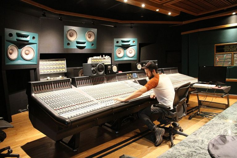 Studio engineer works in a place with fixed acoustics while an FOH engineer needs to anticipate acoustic variances