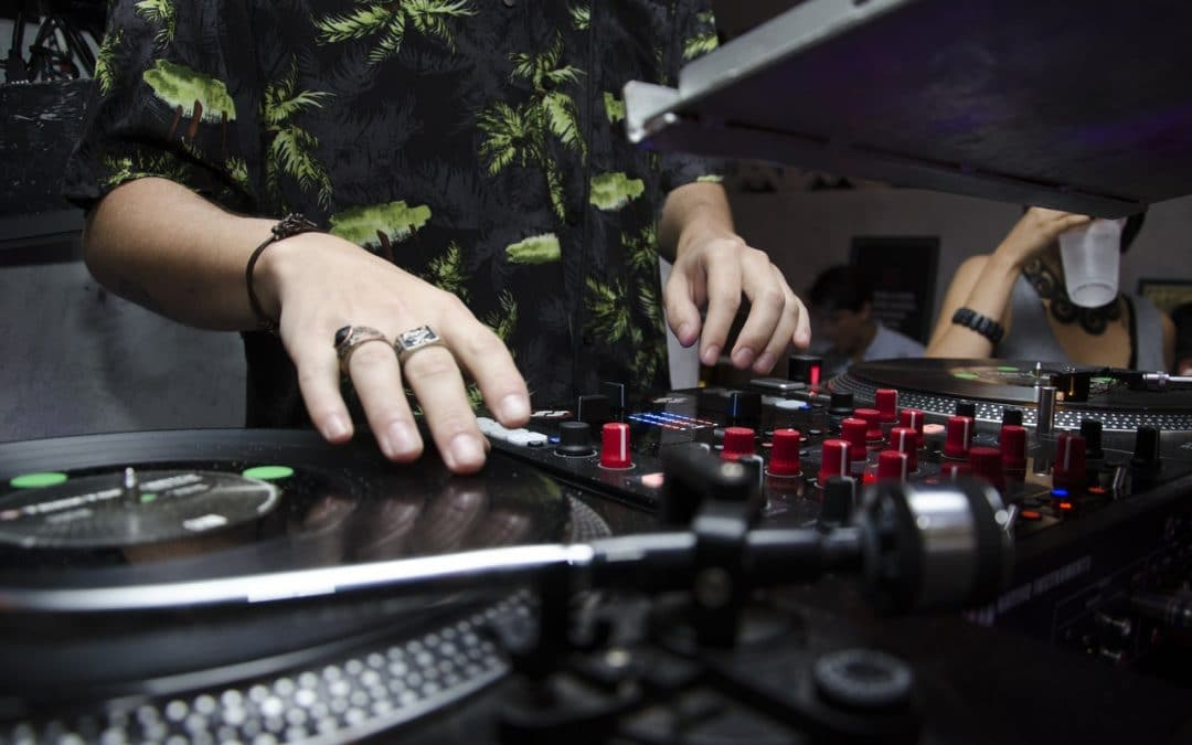 DJ playing vinyl at a show: A furman power conditioner can protect DJ equipment from surges.