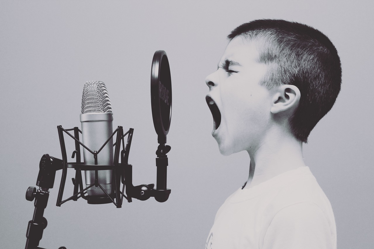 kid singing in a studio