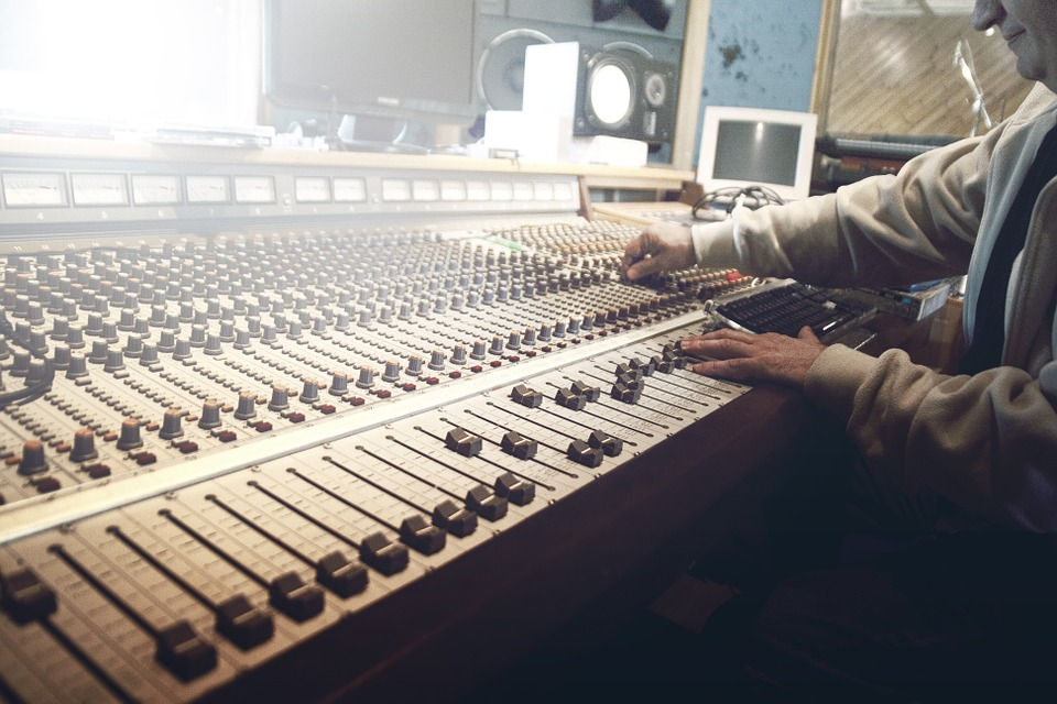 man in a studio mixing sound music